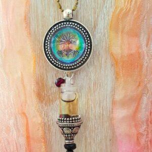 pendentif bijou énergétique arbre de vie et son flacon de synergie vibratoire