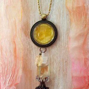 pendentif bijou énergétique fleur de vie et son flacon de synergie vibratoire