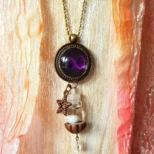 pendentif bijou énergétique infini et son flacon de synergie vibratoire