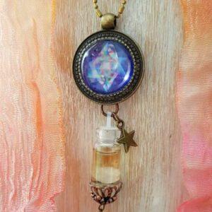 pendentif bijou énergétique merkaba et son flacon de synergie vibratoire